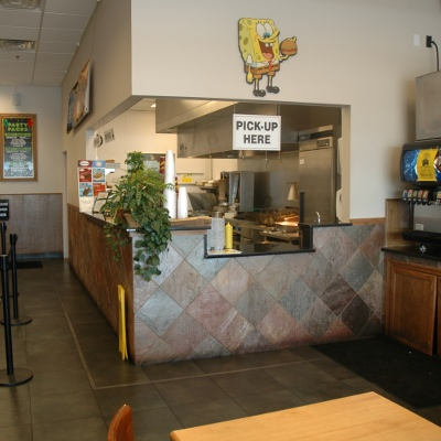 A picture of the store, ordering counter and kitchen at Big Sammy's in Elgin.